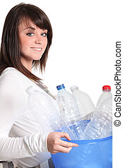 Teenage girl taking the recycling out