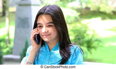 Teenage girl talking on smartphone