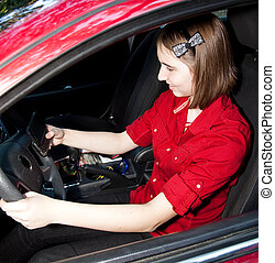 Teenage Girl Texting and Driving - Teen girl texting while...