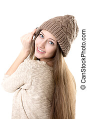 Teenage girl trying on knitted hat