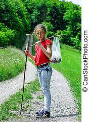 Teenage girl walking in a countryside