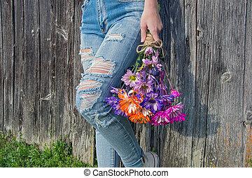 teenage girl wearing frayed jeans