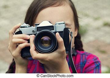teenage girl with a camera