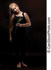 Teenage girl with a flower in her hand