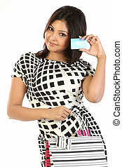 Teenage girl with bags credit card