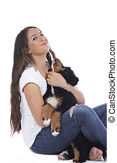 Teenage girl with bernese mountain dog