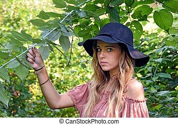 teenage girl with black hat