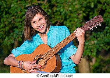 Teenage girl with guitar