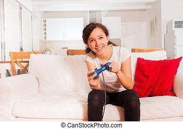 Teenage girl with joystick playing video games