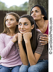 Teenage girl with mother and younger sister