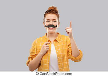 teenage girl with moustaches pointing finger up