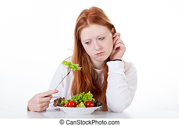Teenage girl with no appetite on white isolated background