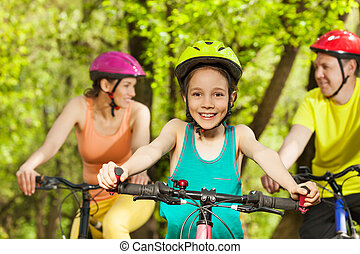 Teenage girl with parents during bike riding