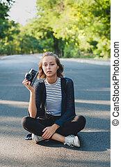 Teenage girl with photo camera
