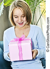 Teenage girl with present