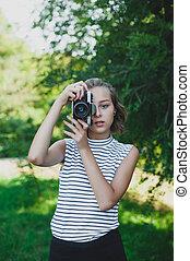 Teenage girl with retro camera