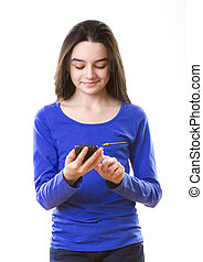 Teenage girl with smartphone on white background.