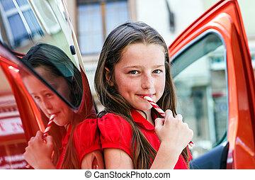Teenage girl with sweet candy