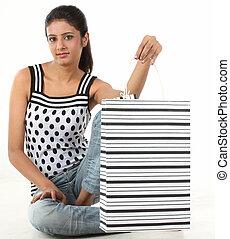 Teenage girl with the shopping bag