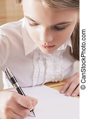 Teenage Girl Writing a Letter