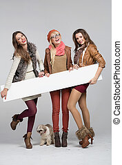 Teenage girls having fun with empty board