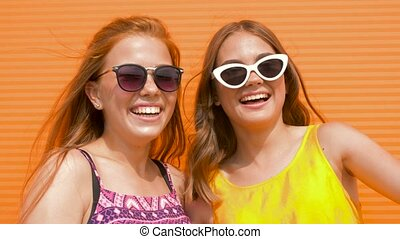 teenage girls in sunglasses showing thumbs up - summer...