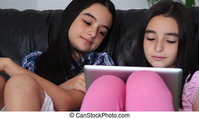 Teenage girls using tablet computer - Two happy teenage ...