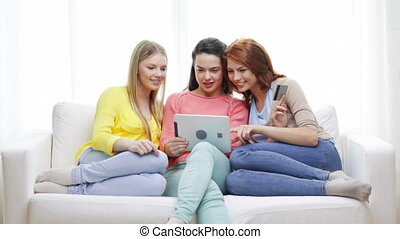 teenage girls with tablet pc and credit card