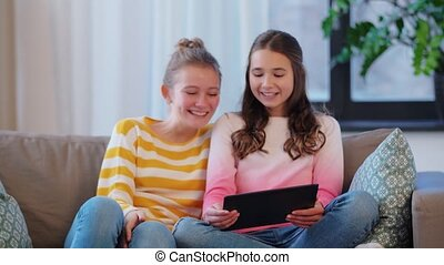 teenage girls with tablet pc having video chat - people, ...