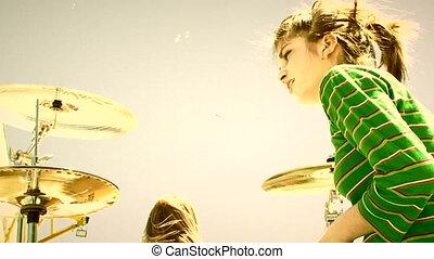 Teenage music - Alternative music band performing outdoors....