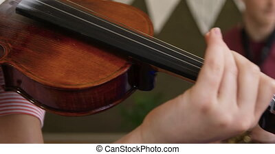 Teenage musicians rehearsing - Side view close up of a ...