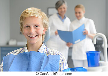 Teenage patient at dental surgery dentist nurse