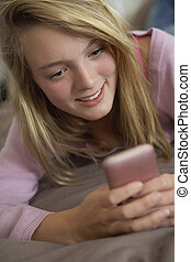teenage, ruchoma głoska, sypialnia, używając, dziewczyna, leżący