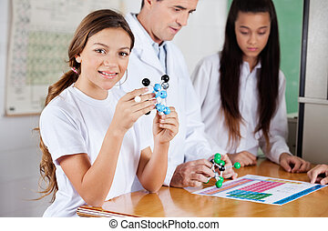 Teenage Schoolgirl With Molecular Structure - Portrait of ...