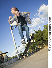 Teenage Skateboarder - Teenage boy skateboarder with his...