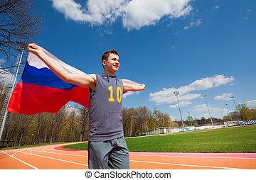 Teenage sprinter waving flag of Russian Federation