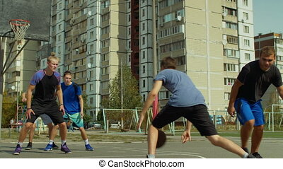 Teenage streetball players in action outdoors - Active...