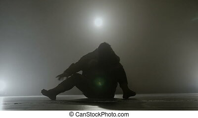 Teenage student performing a sensitive sensual modern dance in front of a smoke background