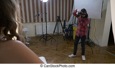 Teenage student photo shooting his girlfriend with a...
