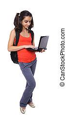 teenage student working on laptop