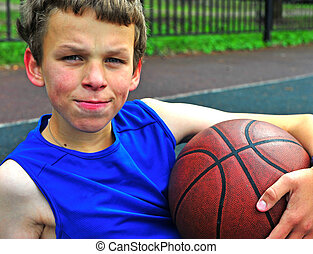 Teenage with a basketball on court