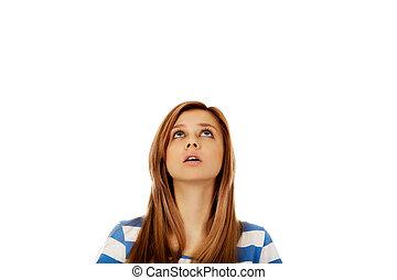 Teenage woman eyes looking up