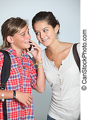 Teenaged girls with mobile phone