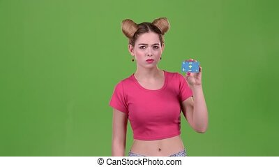 Teenager advertises a card and shows a finger down. Green...