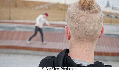 Teenager albino watches on friends performing free run...