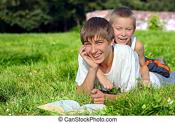 Teenager And Kid In The Park