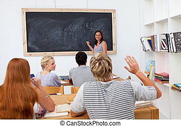 Teenager asking a question in the class - Teenager asking a...