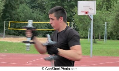 Teenager boxing with dumbbells