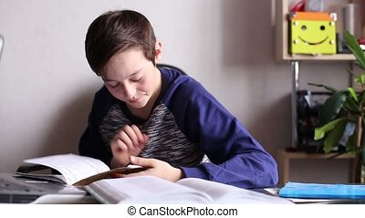 Boy at the Table Reading