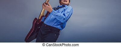 teenager boy brown hair of European appearance playing...